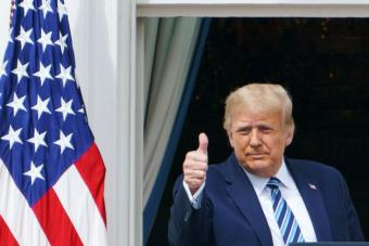 US President Donald Trump greets supporters