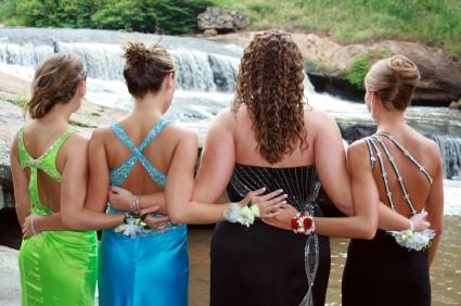 Four friends in prom dresses
