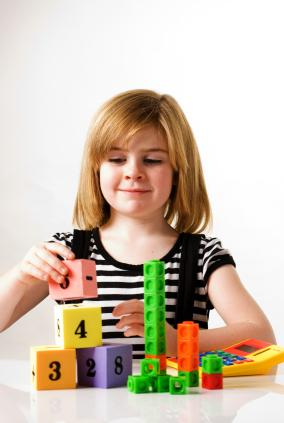 girl with counting blocks