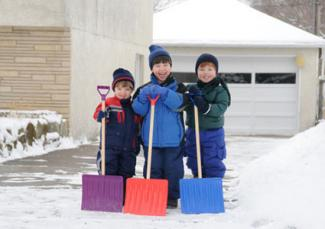 Kids with snow shovels