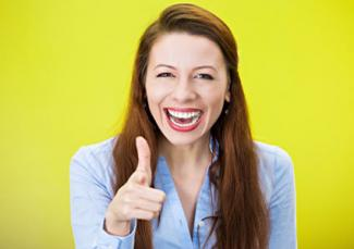 Woman laughing and pointing