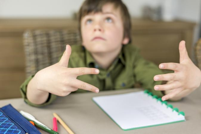 child counting fingers