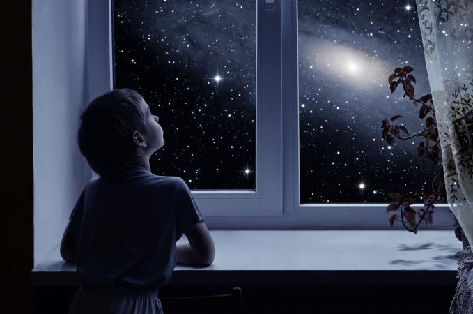 boy gazing at star
