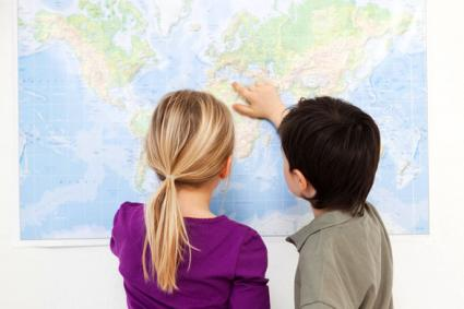 Kids studying continents on world map