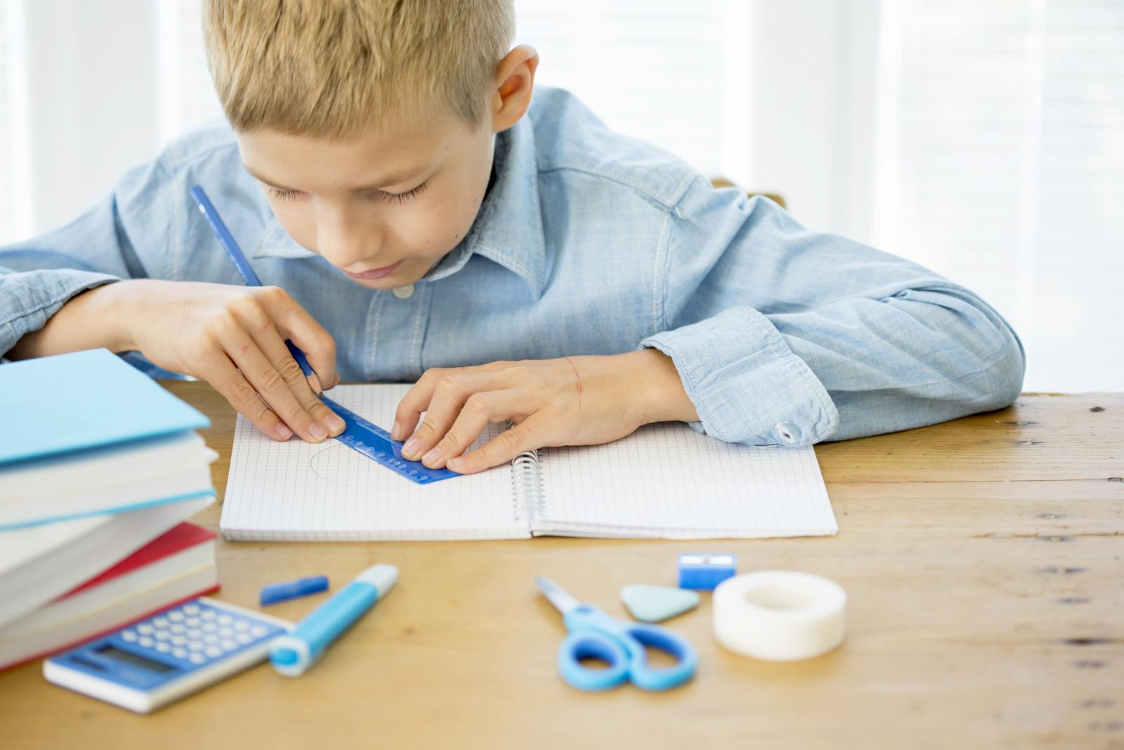 Boy using a ruler