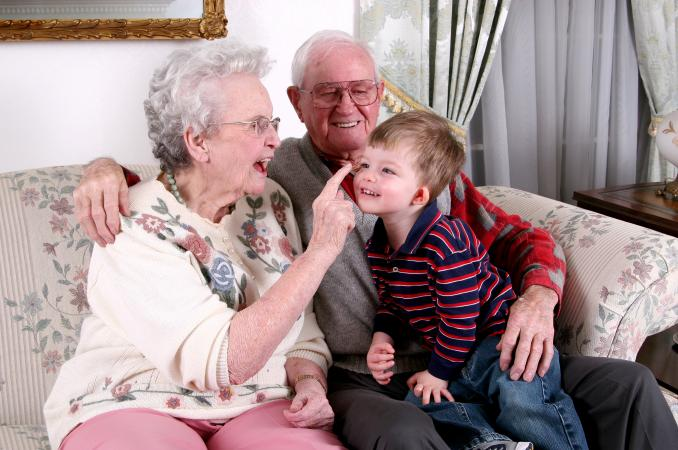 Grandparents playing with their grandchild