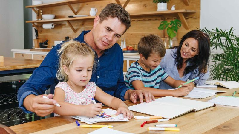Parents helping children with homeschooling