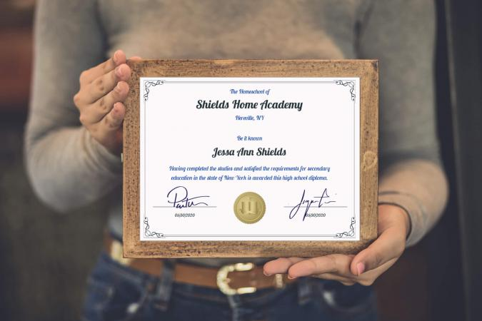 woman holding homeschool diploma