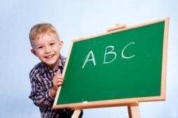 boy learning alphabetical order
