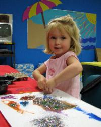 young girl doing art education for homeschoolers