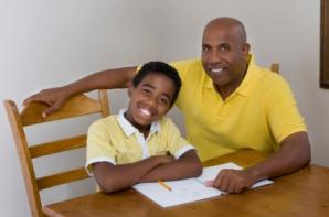 father homeschooling child