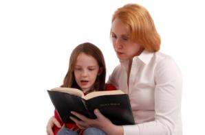 mother and daughter reading Bible together