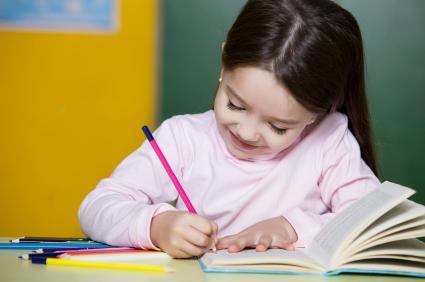 Little girl studying.