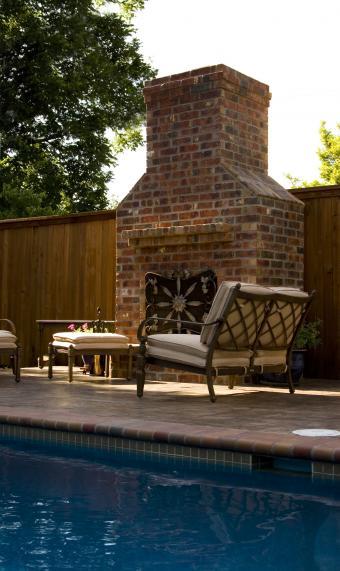 https://cf.ltkcdn.net/homeimprovement/images/slide/104612-506x850-pool_fireplace.jpg