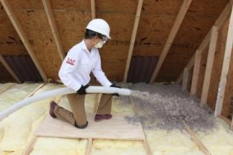 TAP Insulation being blown into attic