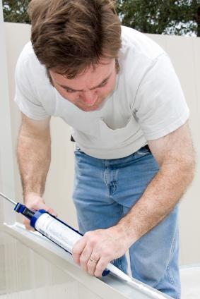 Handyman applying caulk