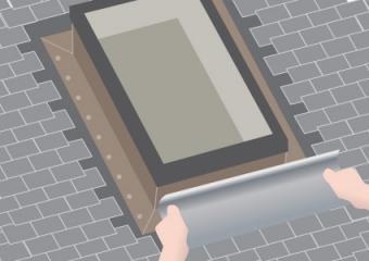 Attaching flashing to skylight flange