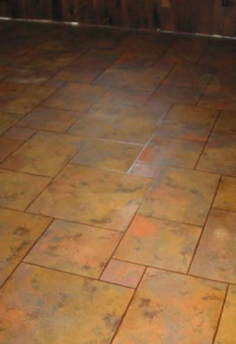 https://cf.ltkcdn.net/homeimprovement/images/slide/185862-550x800-faux-terra-cotta-painted-floor.jpg