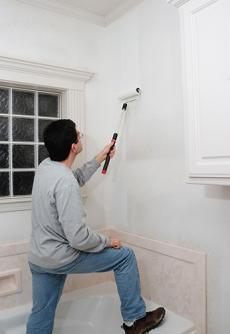 Man painting bathroom