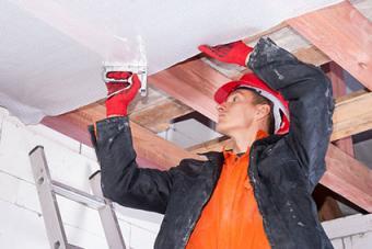 Man installing a vapor barrier