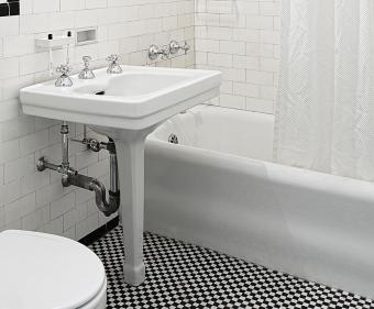 Bathroom with porcelain coated steel bathtub