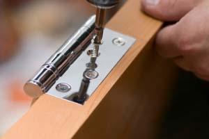 Door hinge being installed.