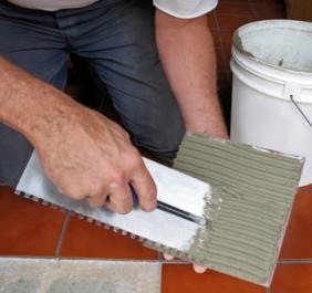 Tile being back buttered