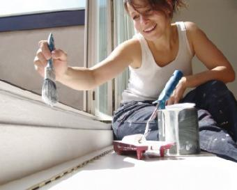 Woman painting sill