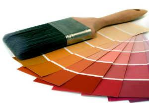 Paint brush with various paint hues.