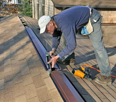 Man caulking roof