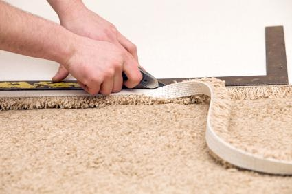 Trimming carpet with carpet knife