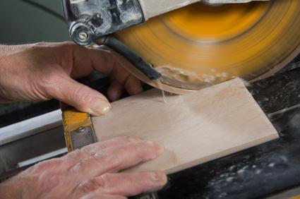 Tile being cut on a wet saw