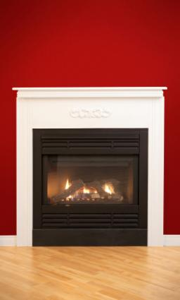 gas fireplace on red wall