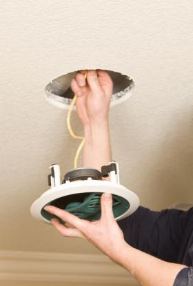 Man installing ceiling speakers