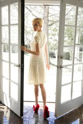 Woman leaving through French doors
