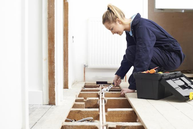 woman doing home repairs