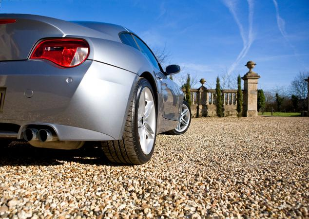 Silver sportscar in driveway