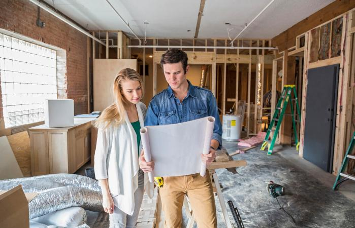 Couple prioritizing home improvement projects