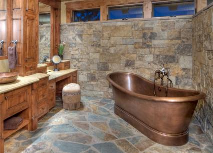 Copper bathtub in rustic bathroom