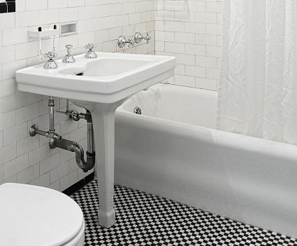 Bathroom with porcelain coated steel bathtub