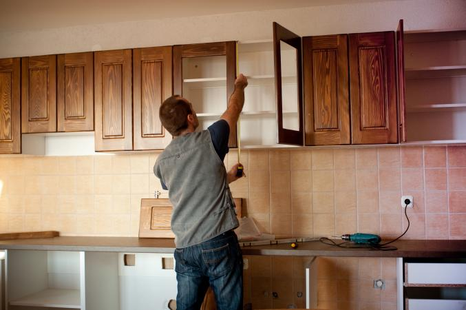 Man working on a kitchen remodel
