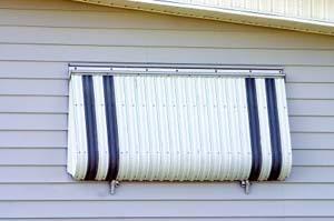 Aluminum awning turned into hurricane shutter.