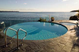 Pool with stone tile decking.