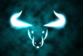 Taurus bull symbol on a smoky teal background