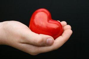 Image of a hand offering a heart