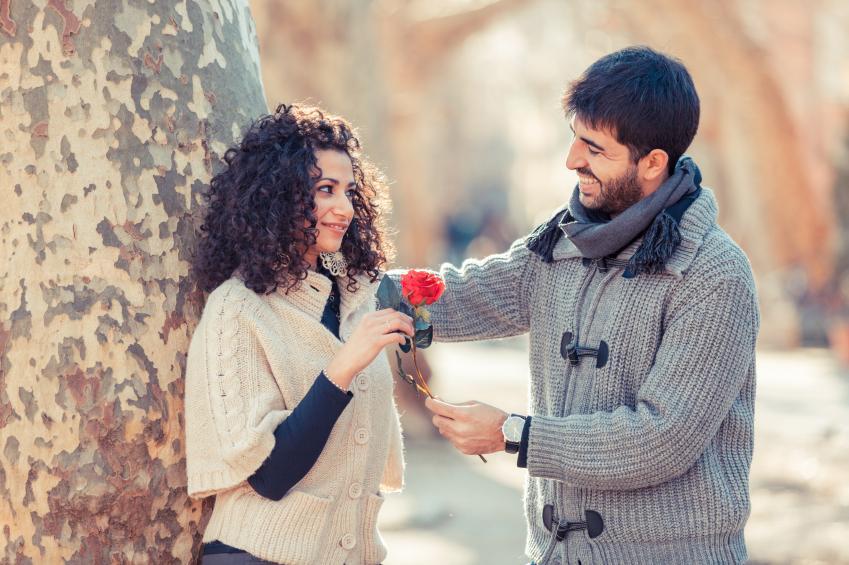 https://cf.ltkcdn.net/horoscopes/images/slide/170651-849x565-Man-giving-a-woman-a-flower.jpg