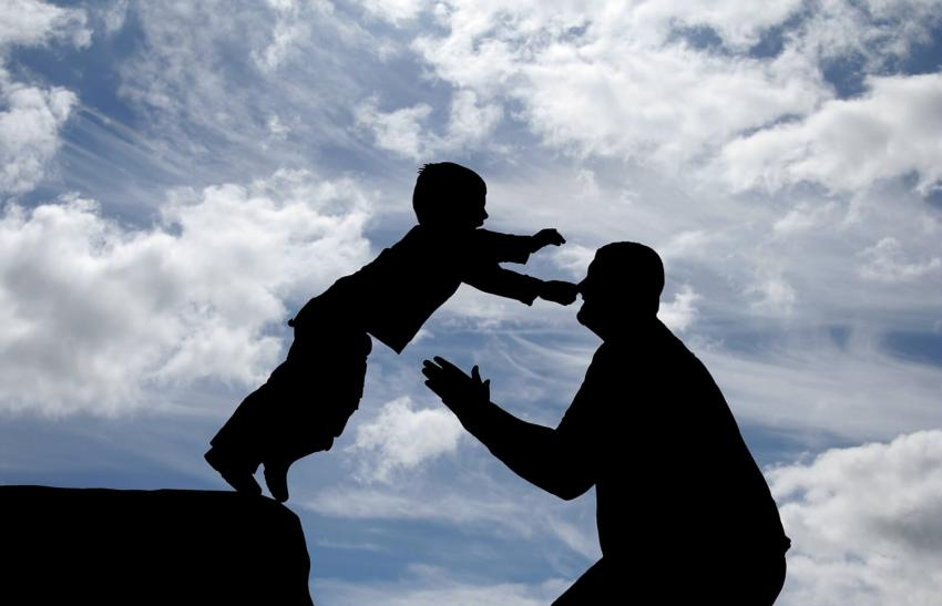 Son jumping into the arms of his father