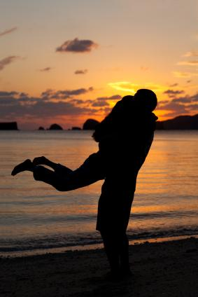 Twirling embrace on the beach
