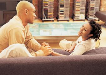 Virgo man and his partner talking on sofa
