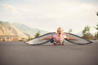 Girl with Wings On Skateboard